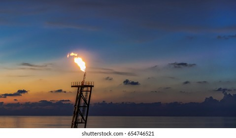 Oil and Gas Production Flare view with beautiful sunset golden sky background