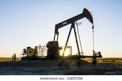 Oil and Gas. A Pump Jack in an oilfield in Southern Alberta
