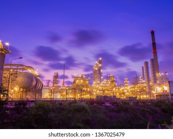 Oil and gas refinery industrial plant at sunset time.