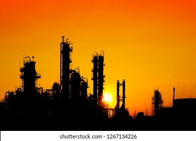 Oil and gas refinery industry in silhouette image on orange sky sunset background, Petrochemical plant, Factory of petroleum at evening