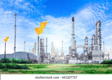 Oil and gas refinery plant with flare stack on blue sky background , petrochemical plant , Petroleum