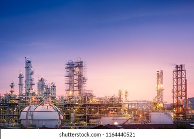 Oil and gas refinery plant or petrochemical industry on sky sunset background, Factory with evening, Gas storage sphere tank in petrochemical industrial