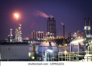 Oil and gas refinery plant or petrochemical industry in twilight time, Gas storage sphere tank and distillation tower in petroleum plant