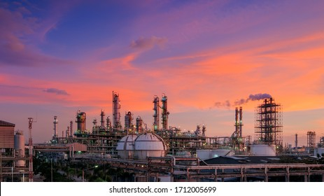 Oil and gas refinery plant or petrochemical industry on sky sunset background, Factory with evening, Manufacturing of petrochemical industrial