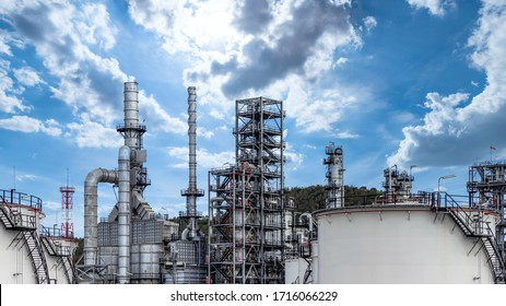 Oil and gas refinery plant and storage tank form industry zone with blu sky background, Oil and gas Industrial petrochemical fuel power and energy, Ecosystem and ecology environment.