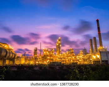 Oil and gas refinery plant with sunset.