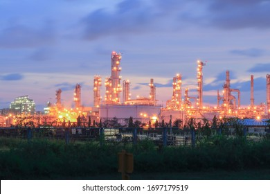 Oil and gas refinery at sunset -factory -petrochemical plant twilight