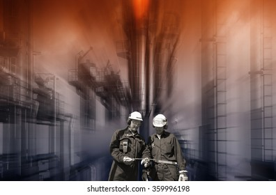 oil and gas workers with chemical oil refinery in background, safety-flame burning