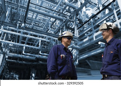oil and gas workers inside refinery industry, pipelines constructions