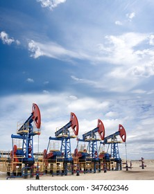 Oil industry and gas industry. Oil equipment. Blue sky and white clouds