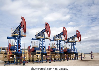 Oil industry and gas industry. Work of oil pump jack on a oil field. Oil equipment