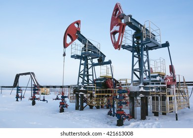 Oil industry and gas industry. Work of oil pump jack on a oil field.