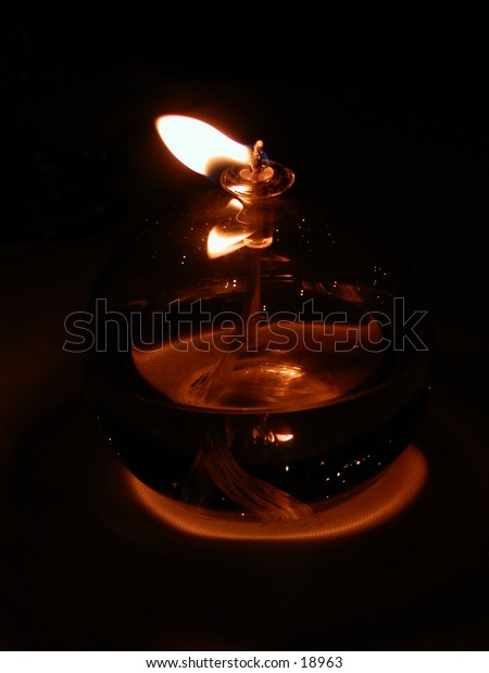 Oil lamp with a flame blowing in the wind.
