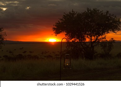 Oil Lamp in front of African Orange Sunset