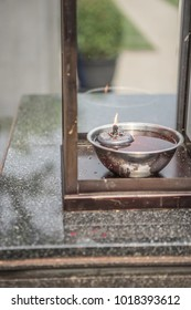 An Oil lamp in front of the Chinese shrine in Bangkok, Thailand.
