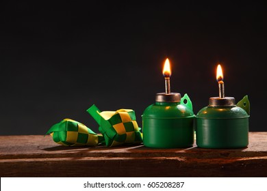 oil lamp with words selamat hari raya means greeting of muslim's new year and decoration dumpling