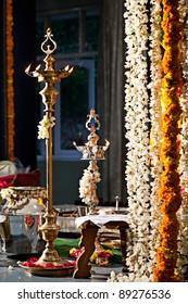Oil lamps flower garlands Indian wedding ceremony