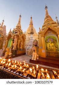 Oil lamps lit by visitors to the Shwedagon Pagoda in Yangon, Myanmar.
