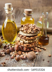 oil and mixed nuts on a rustic background