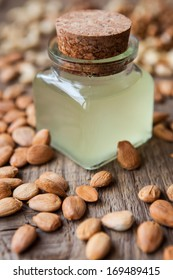 oil and nuts on a wooden background