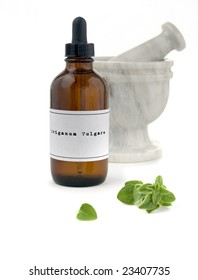 Oil of oregano, a herbal medicine against cold and flu. Latin name: Origanum vulgare. The label was made for the photo shoot, no infringement issues.