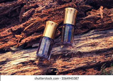 Oil Oudh. Arabic oil Oud natural background of tree bark.