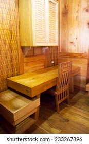 oil paint effect on the image of wooden table, chair and cabinet