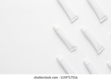 oil paint tubes on white background. not isolated with copy space