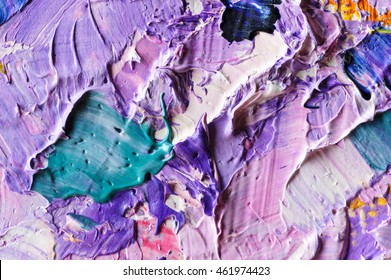 Oil paints mixed on canvas, artist's palette, material texture, studio shot, colorful abstract art background