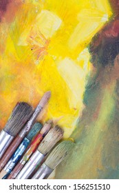 oil paints and paint brushes on a palettes and paint brushes on a palette