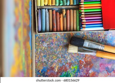 Oil paints palette with paint brushes, colour pencils and pastel - Shutterstock ID 680156629