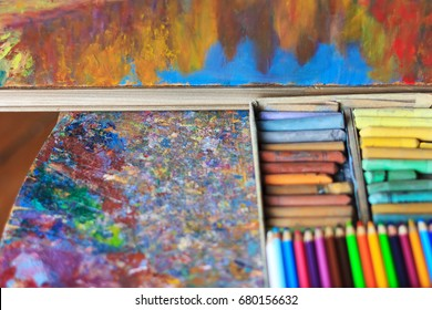 Oil paints palette with paint brushes, colour pencils and pastel - Shutterstock ID 680156632