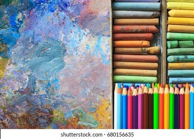 Oil paints palette with paint brushes, colour pencils and pastel - Shutterstock ID 680156635