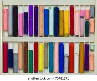 Oil pastel sticks in plastic case
