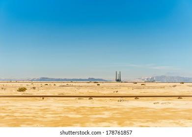 oil pipeline and oil rig in the Sahara desert, Egypt.