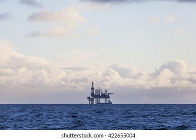 Oil platform in Norway at sunset
