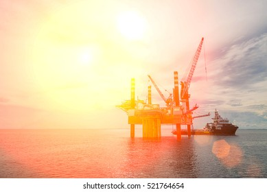 Oil platform or rig platform in sunset or sunrise time.