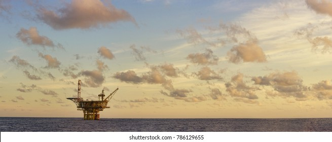oil platform at sea during sunrise
