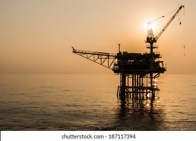 oil platform silhouette when sun set