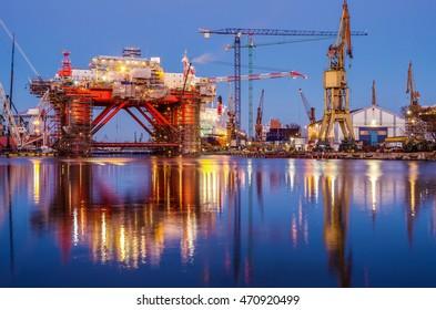 The oil platform under construction in the shipyard at dusk. Gdansk. Poland.