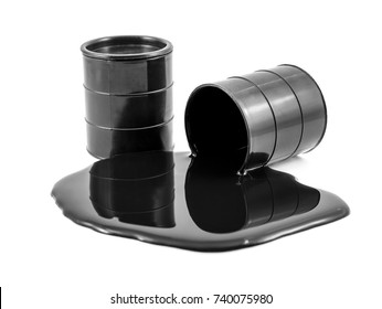Oil is poured out of the black barrel and full barrel of oil. Isolated on white.