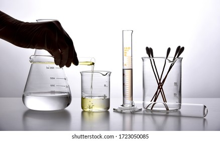 Oil pouring in water, Equipment and science experiments, Formulating the chemical for medicine, Organic extract pharmaceutical, Alternative medicine concept.