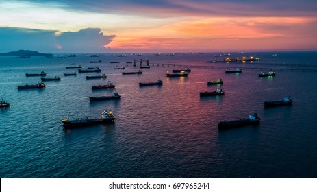 Oil product tanker chemical and gas LPG tanker ship loading in port at twilight, Business industry fuel power and energy.