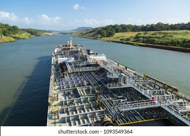 Oil product tanker is proceeding throught the Panama Canal at day time.