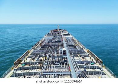 Oil product tanker steaming through blue ocean.