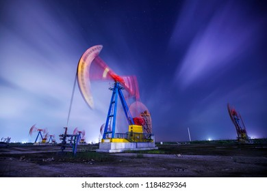 The oil pump and flow cloud in the evening