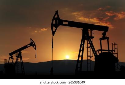 oil pump jack against sunset