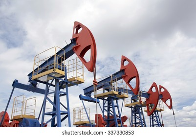 Oil pump jack. Oil and gas industry. Oil field