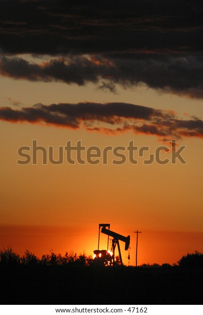 oil pump jack in silhouette
