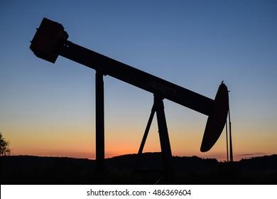 Oil pump jack at sunset.